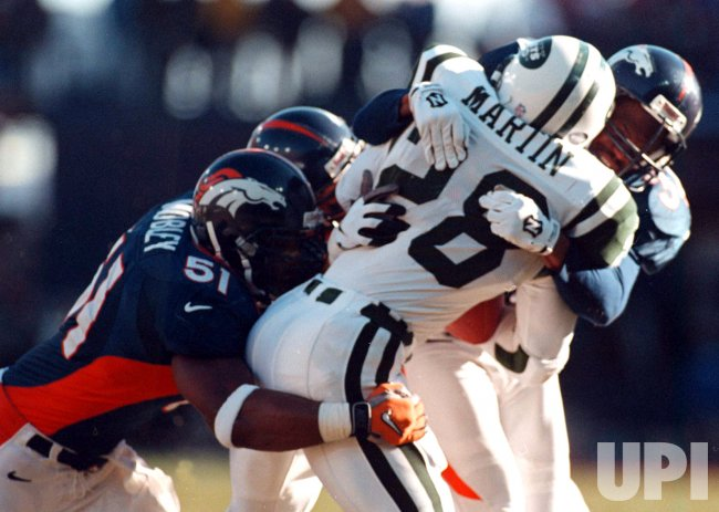 New York's Curtis Martin is taken down during the first quarter of the AFC Championship