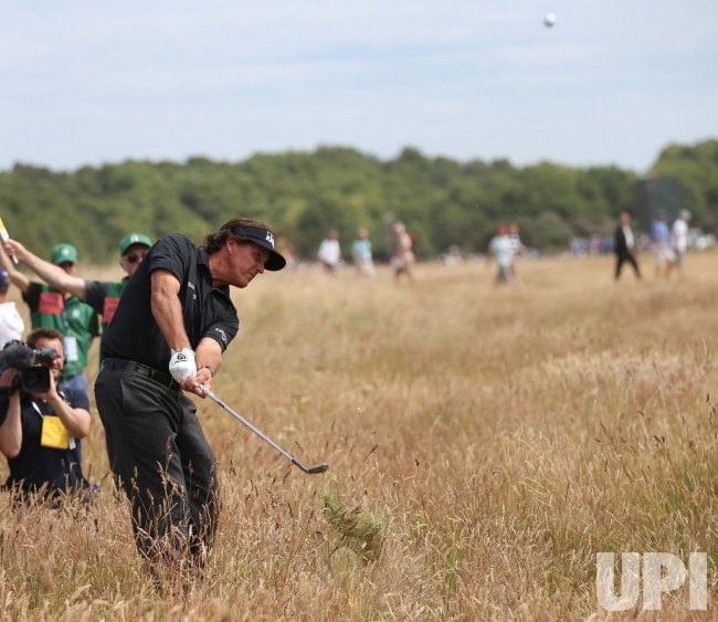 Phil Mickelson hits out of the rough on 8th hole at the Open Championship