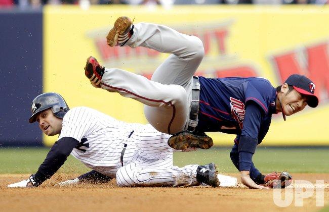 New York Yankees Nick Swisher injures Minnesota Twins Tsuyoshi Nishioka at Yankee Stadium in New York