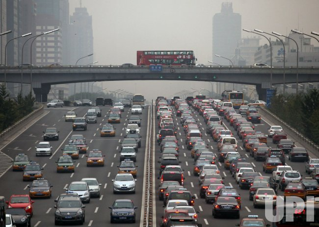 Heavy traffic grinds along a main road in Beijing