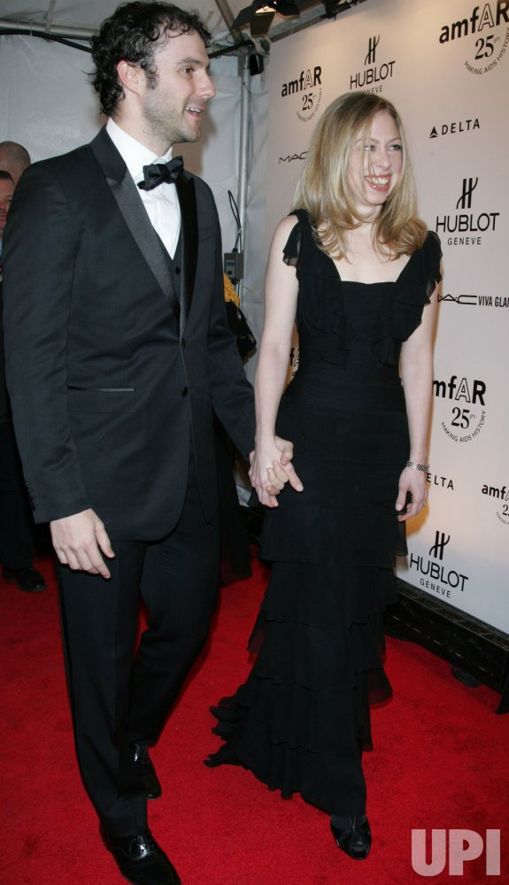 Chelsea Clinton and Marc Mezvinsky arrive for the amfAR New York Gala in New York