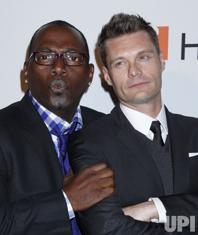 Randy Jackson and Ryan Seacrest arrive at the Clive Davis Pre-Grammy Gala in Beverly Hills
