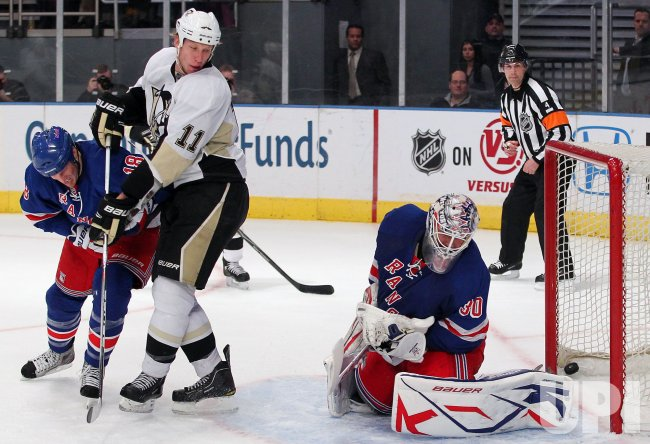 Pittsburgh Penguins Jordan Staal (11) and New York Rangers Henrik Lundqvist react at Madison Square Garden in New York