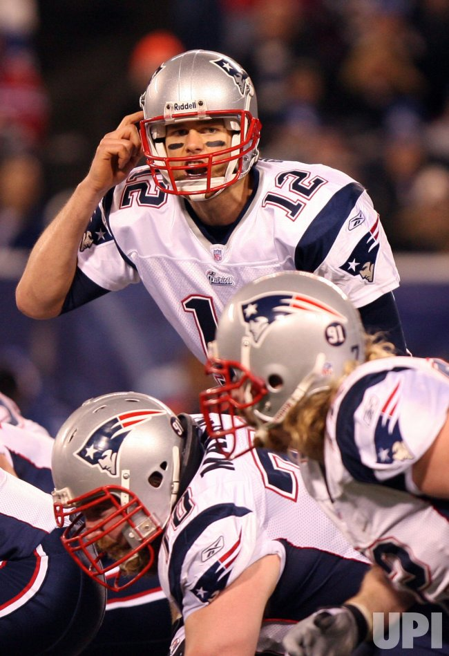 New England Patriots play for a perfect 16-0 regular season record against the New York Giants in New Jersey