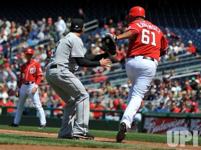 Marlins' Anibal Sanchez tags out Nationals' Hernandez in Washington
