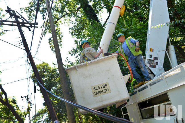 Linesmen work to restore power in Maryland