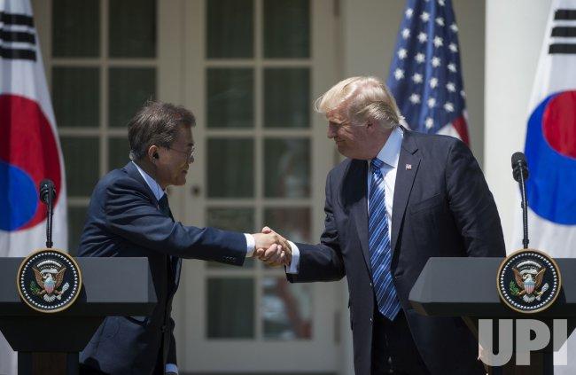 Korean President Moon Jae-in shakes hands with Donald Trump in the Rose Garden