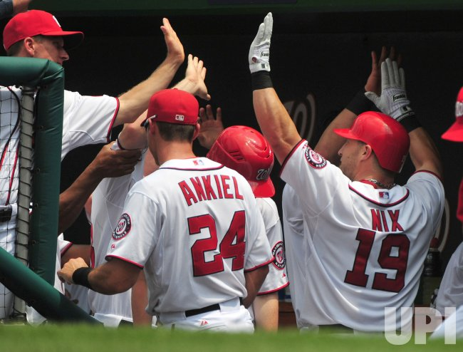 Nationals' Laynce Nix is congratulated by teammates after hitting a solo homerun in Washington.