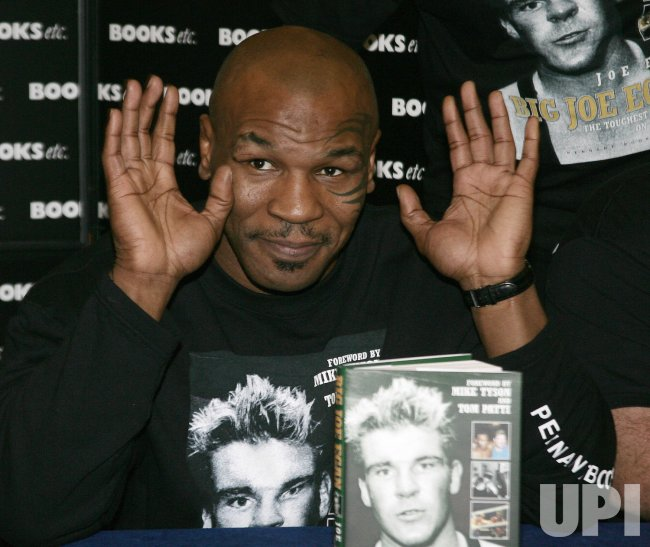 MIKE TYSON ATTENDS BOOK SIGNING IN LONDON