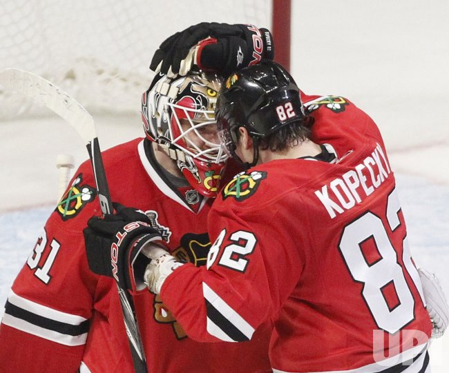 Blackhawks Niemi and Kopecky celebrate win in 2010 Stanley Cup Final