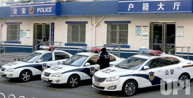 Police Officer Gets in Car at Police Station in Beijing, China