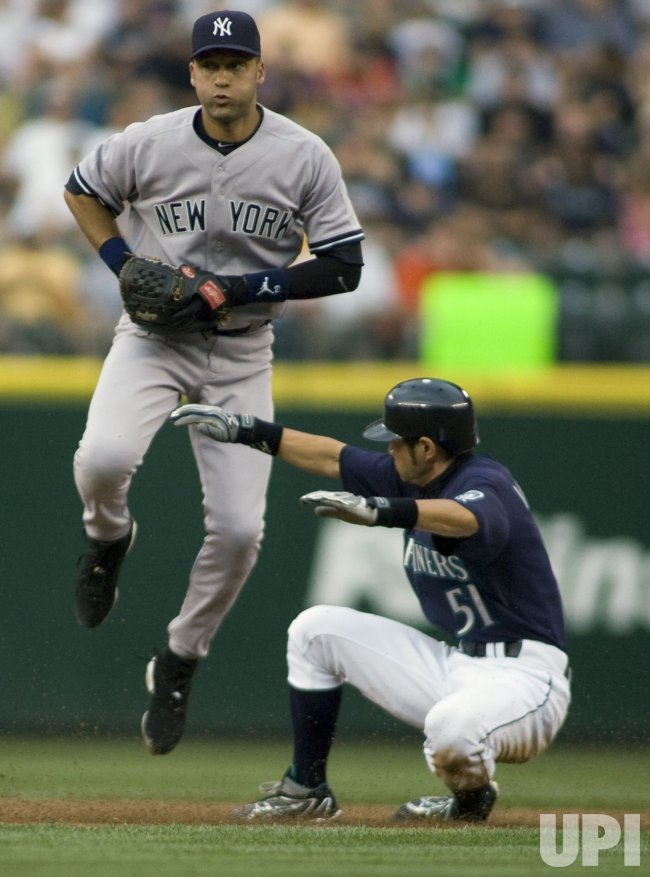 Ichiro Suzuki (R) breaks up a double play attempt by New York Yankees' Derek Jeter in Seattle.