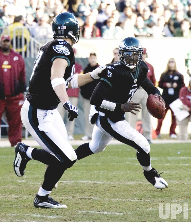 Philadelphia backup quarterback Michael Vick looks for receiver in the 3rd.