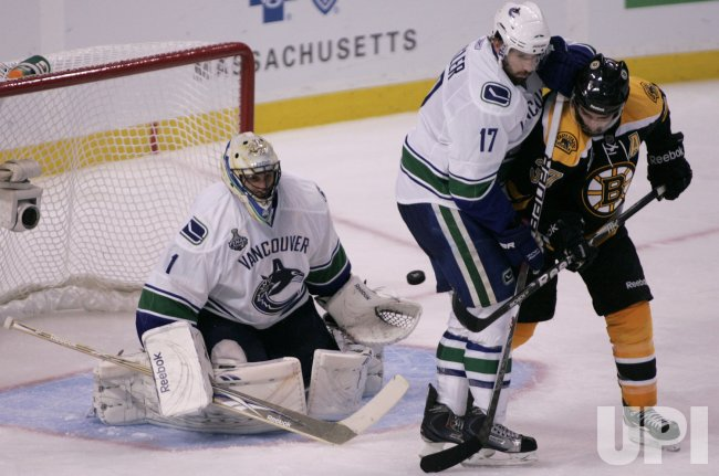Bruins Bergeron attempts shot against Canucks Luongo in game 3 of Stanley Cup Finals in Boston, MA.