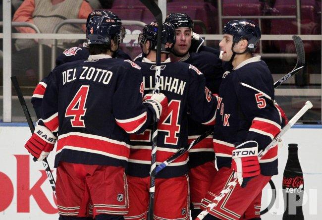 New York Rangers Ryan Callahan, Michael Del Zotto, Dan Girardi (5) and Brandon Dubensky react at Madison Square Garden in New York