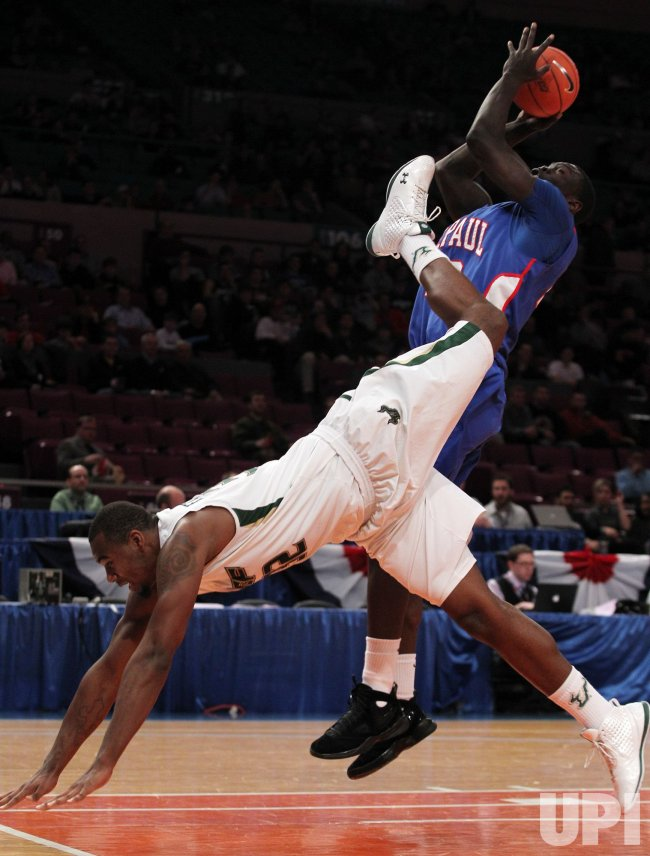 USF Bulls Toarlyn Fitzpatrick (32) dives forward playing defense on DePaul Blue Demons Mac Koshwal at the NCAA Big East Men's Basketball Championships in New York