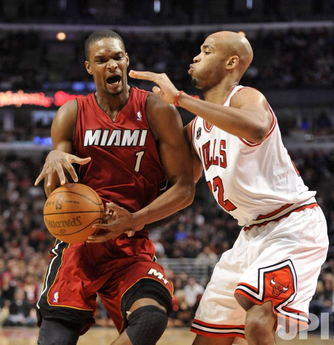 Heat's Bosh drives on Bulls Gibson in Chicago