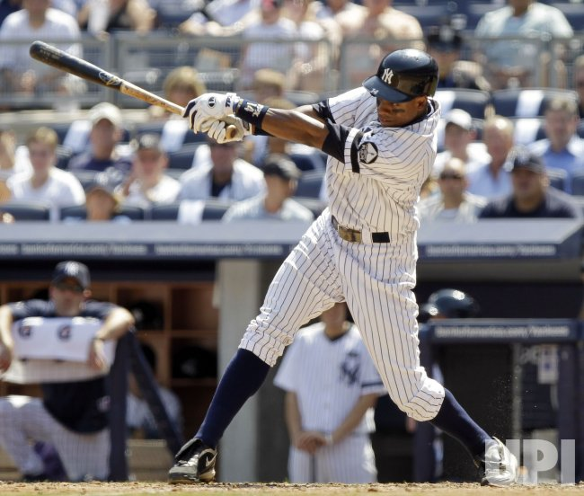 New York Yankees Curtis Granderson hits an RBI single at Yankee Stadium in New York