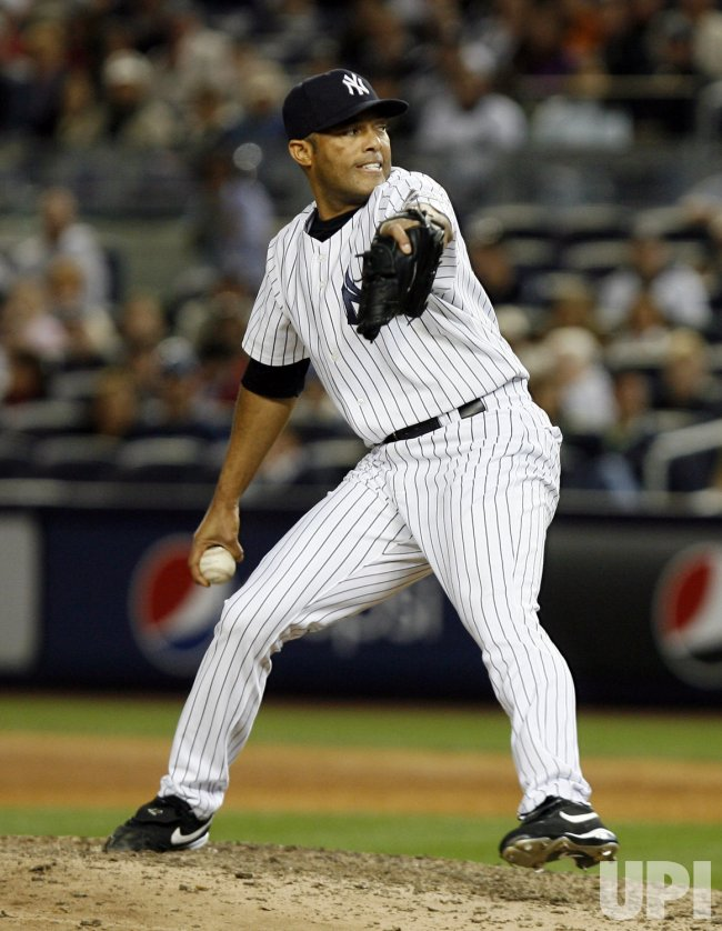 New York Yankees closer Mariano Rivera throws a pitch in the ninth inning against the Boston Red Sox at Yankee Stadium in New York