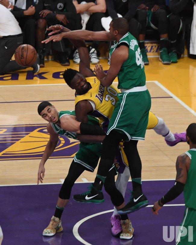Celtics center Al Horford (R) blocks the shot of Lakers forward Julius Randle