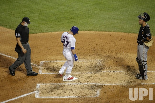Cubs Jason Kipnis hits a solo home run at Wrigley Field in Chicago