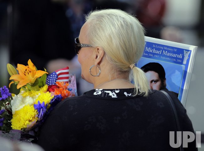 A woman holds memories at 9/11