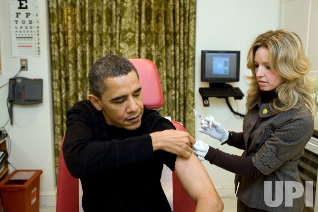 President Obama receives an H1N1 vaccine in Washington