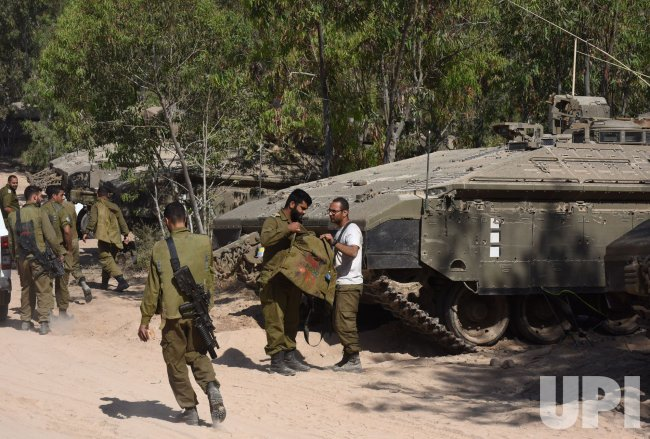 Israeli Soldiers Walk In A Staging Area On The Israel-Gaza Border