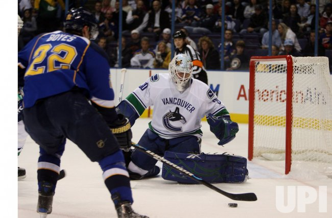 St. Louis Blues Brad Boyes shoots puck