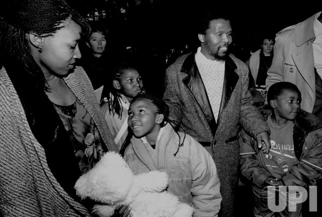 Zenani Mandela Dlamini and Family at Logan International Airport