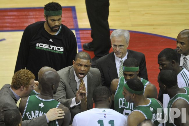 Celtics Rivers talks during timeout