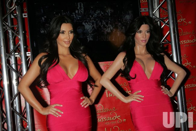 Kim Kardashian and wax figure at Madame Tussauds in New York