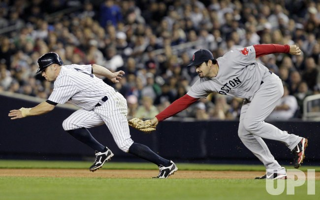 Boston Red Sox Adrian Gonzalez tags out New York Yankees Brett Gardner at Yankee Stadium in New York
