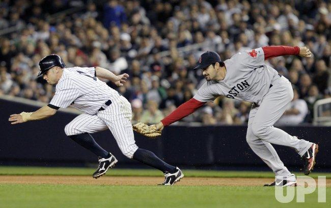 Boston Red Sox Adrian Gonzalez tags out New York Yankees Brett Gardner at Yankee Stadium in New York