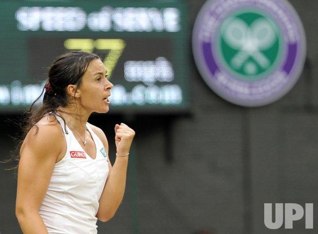 Marion Bartoli reacts at Wimbledon.