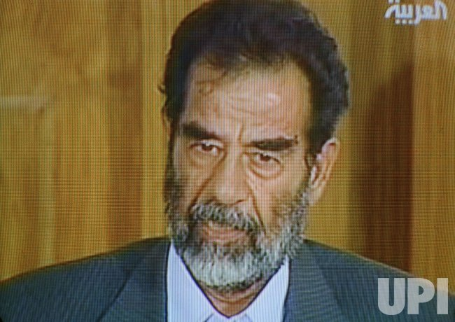 SADDAM HEARS CHARGES AGAINST HIM