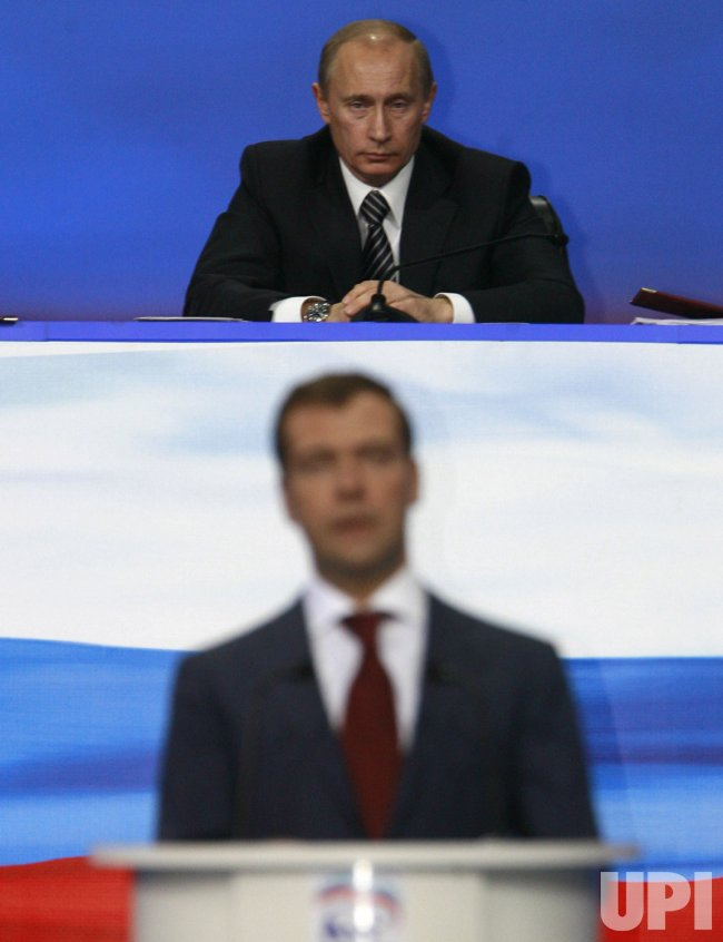 Russian President Putin and his protege Medvedev attend the United Russia party congress in Moscow