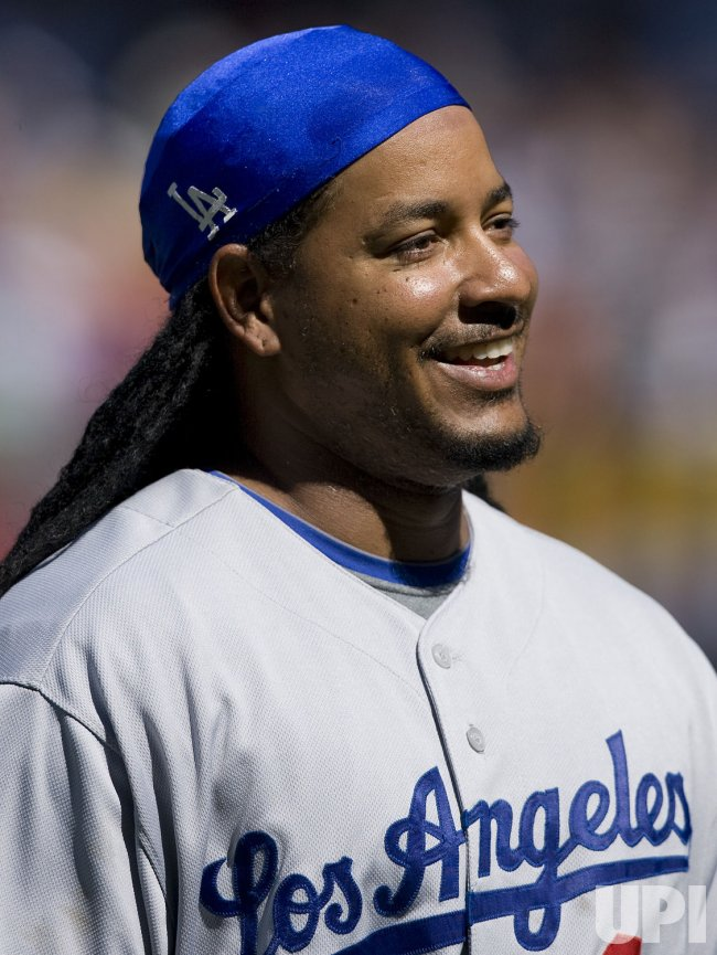 Dodgers Ramirez Endures Boos with a Smile in Denver