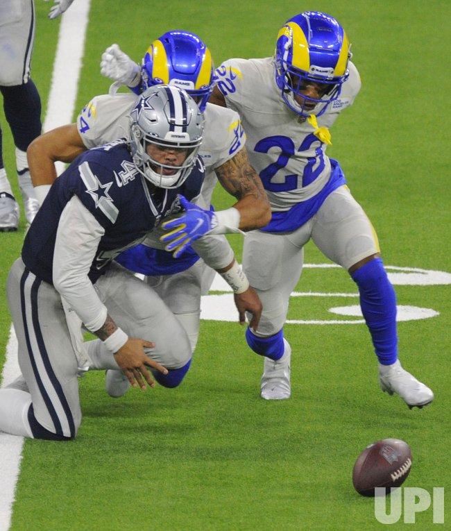 Cowboys' Dak Prescott Fumbles The Ball As Rams' Troy Hill Scrambles For It