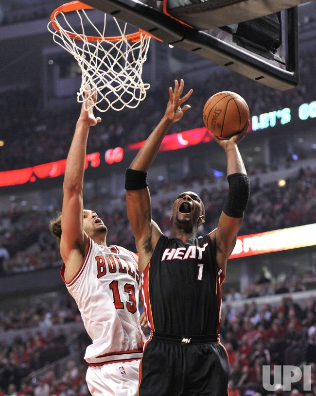 Heat's James goes up for shot as Bulls' Noah defends in Chicago