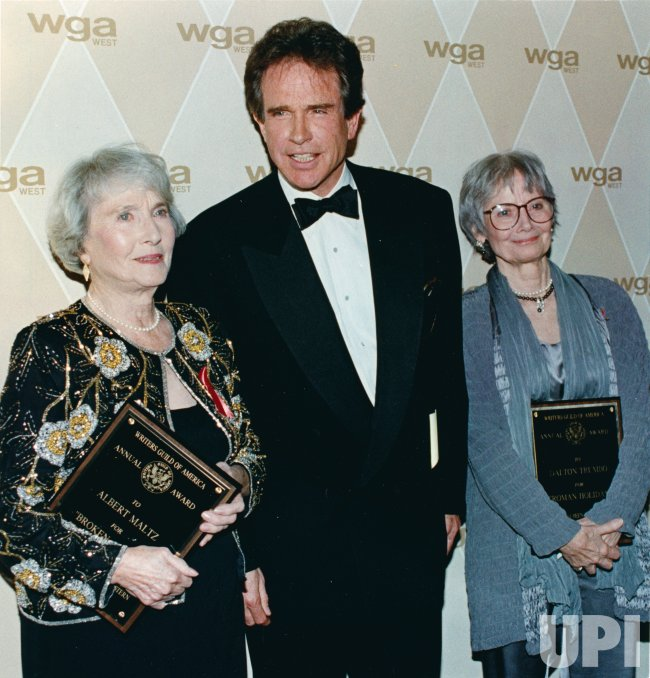 """Actor Warren Beatty (C) poses with the widows of Albert Maltz and Dalton Trumbo, two writers, who because of the anti-communist """"blacklist"""" of the 1950s period were prevented from taking credit for their films. The American Writers Guild Awards, originall"""