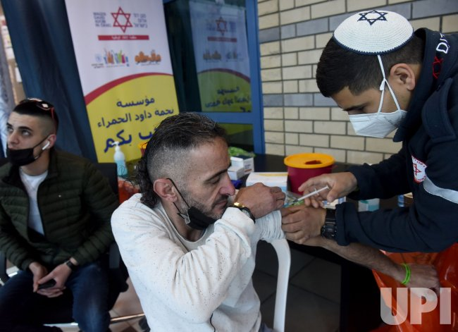 A Palestinian Receives The Pfizer-Biotech Coronavirus Vaccine At The Qalandiya Checkpoint