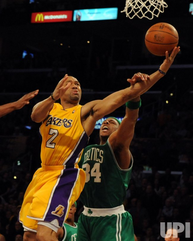 Lakers' Fisher is hit on arm against Celtic's Pierce during NBA game in Los Angeles