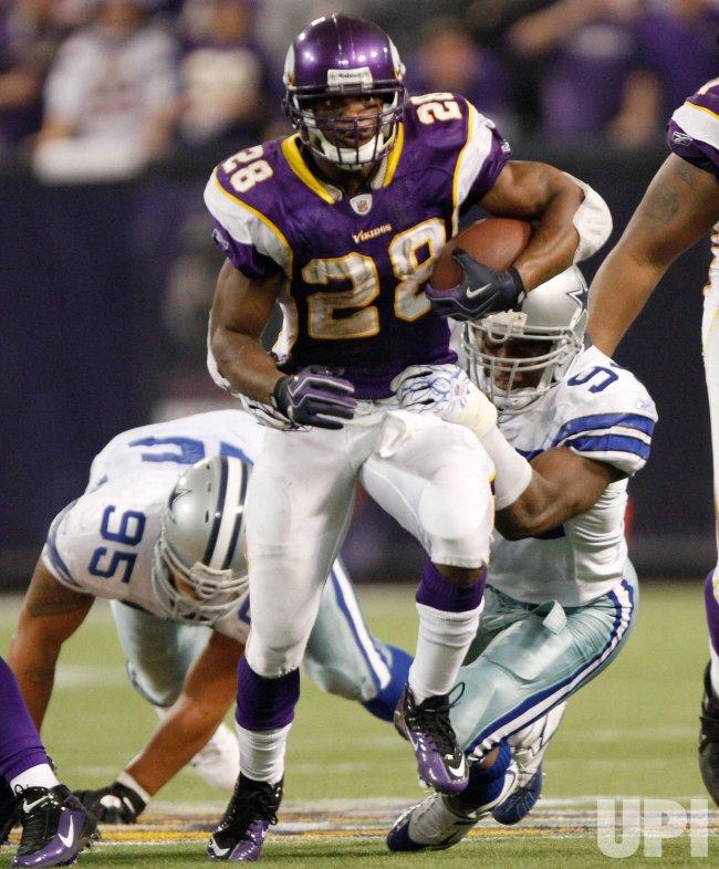 Vikings' Peterson runs for a gain against the Cowboys in Minneapolis