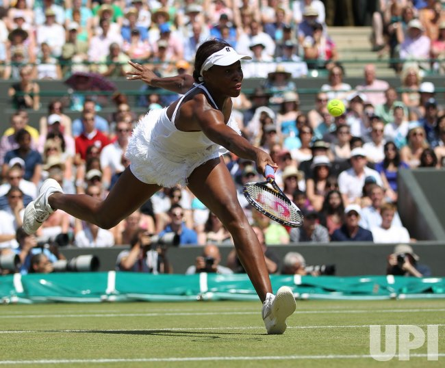 Venus Williams stetches for the ball at the Wimbledon Championships