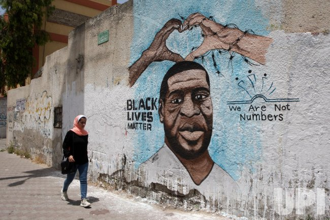 A mural depicts George Floyd in Gaza