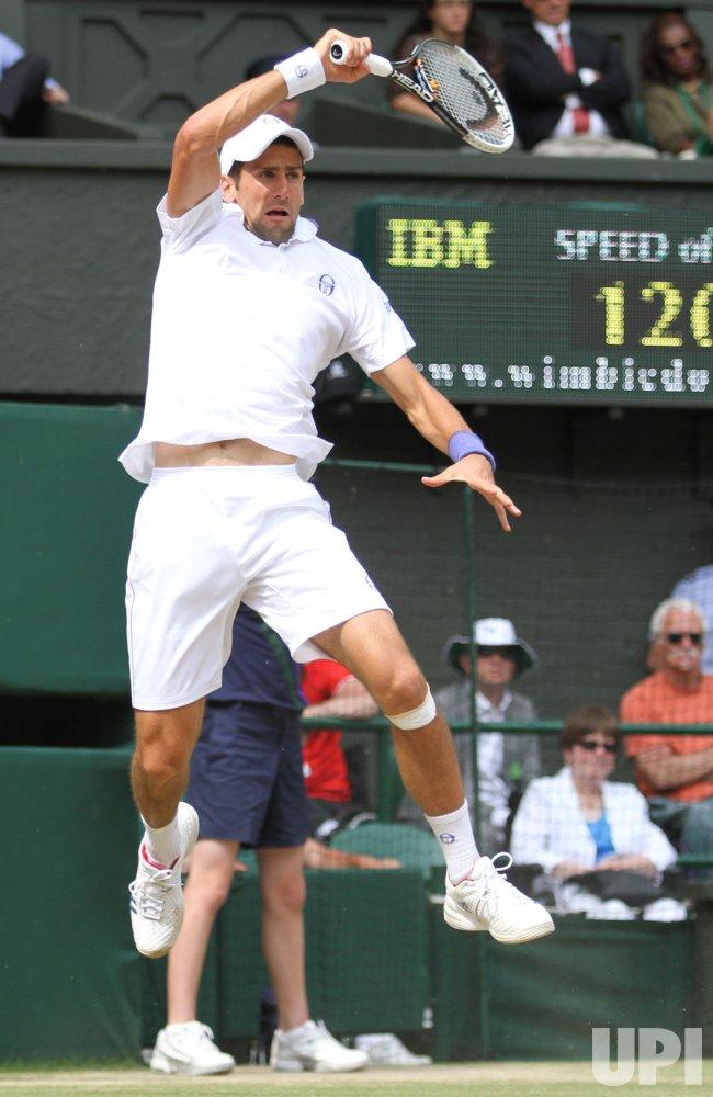 Novak Djokovic returns in the Mens Singles Final at Wimbledon.