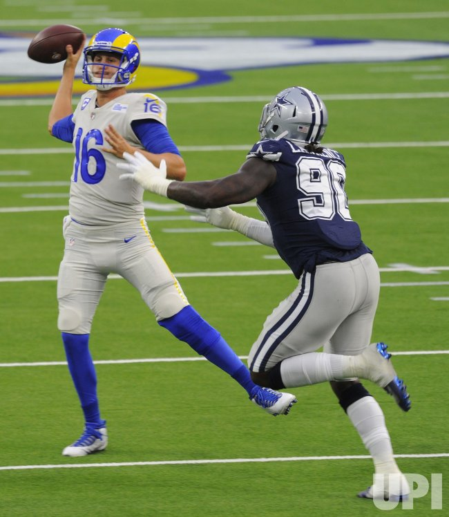 Cowboys' DeMarcus Lawrence puts pressure on Rams' Jared Goff