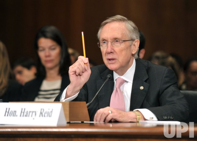 Senate Majority Leader Harry Reid testifies on prohibiting anti-competitive practices in the health insurance industry in Washington