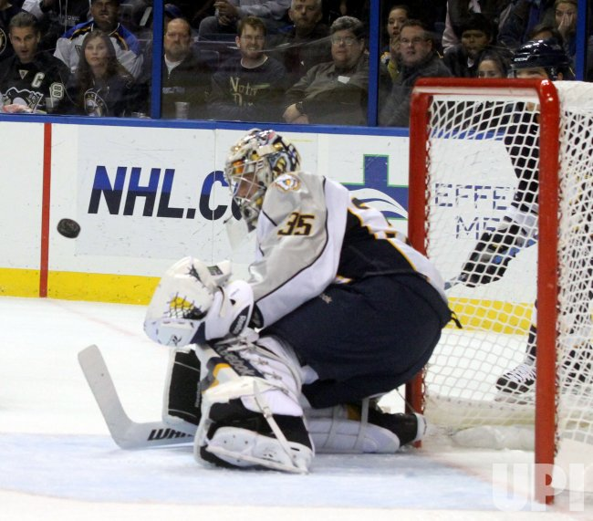 Predators goalie Pekka Rinne blocks a shot in St. Louis